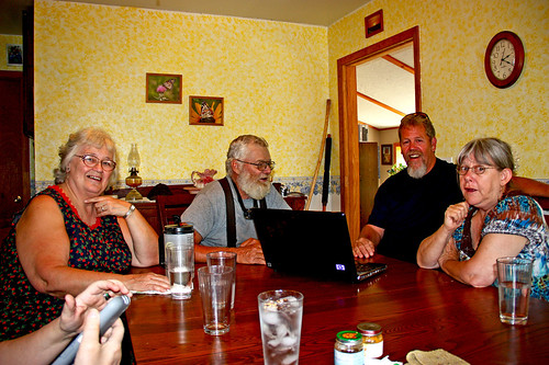 Mom, Dad, Uncle Mike & Aunt Pat sitting around my dining room table talking.