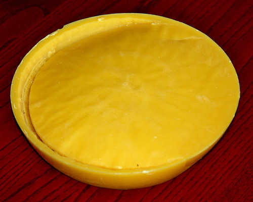 Beeswax!  Galen asked the guy we get honey from if he had any beeswax he had no use for a while back, and when he went to talk to him today he walked away with this!  It's the size of a pie plate, so should keep me in beeswax for salve for a little while!!  Would LOVE to have more to use for candles, but will live with enough for salve quite happily.  :-))